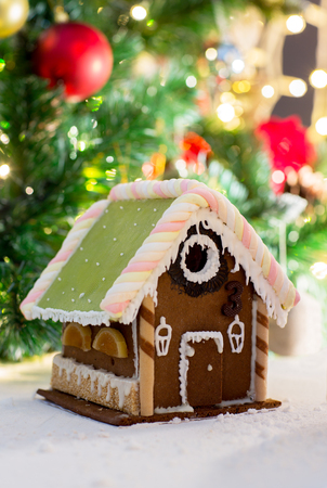 sugarcoated: holidays, christmas, baking and sweets concept - closeup of beautiful gingerbread house on table