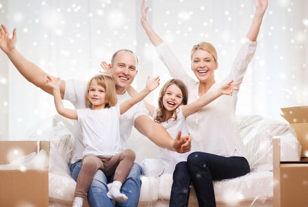 family, people, accommodation, gesture and happiness concept - smiling parents and two little girls moving into new home and waving hands over snowflakes background photo