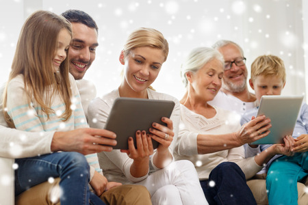 three generation: family, generation, technology and people concept - smiling family with tablet pc computers at home