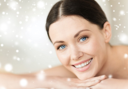 woman in towel: beauty, health, people and spa concept - beautiful young woman in spa