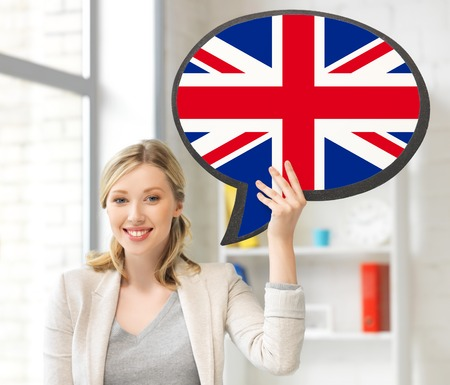 british people: education, fogeign language, english, people and communication concept - smiling woman holding text bubble of british flag