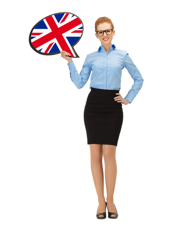 education, foreign language, english, people and communication concept - smiling woman holding text bubble of british flag photo