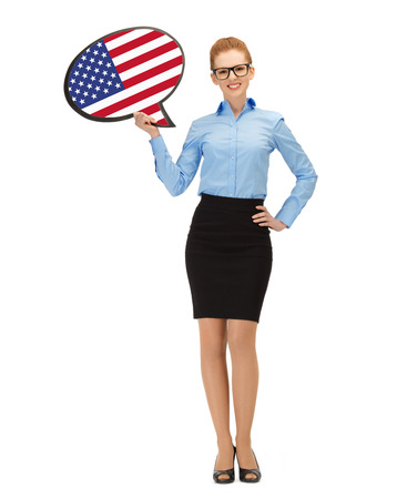 education, foreign language, english, people and communication concept - smiling woman holding text bubble of american flag photo