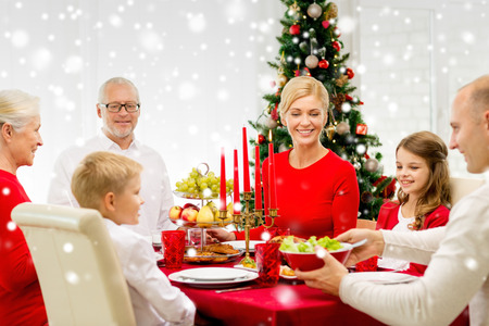 three generation family: family, holidays, generation, christmas and people concept - smiling family having dinner at home