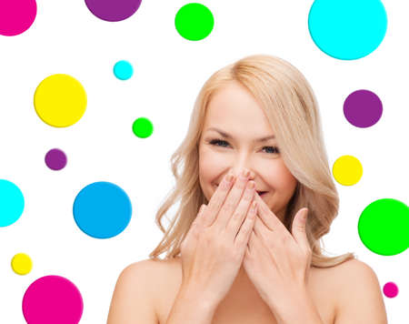 one eye: people and beauty concept - beautiful smiling young woman winking one eye over colorful polka dot pattern background