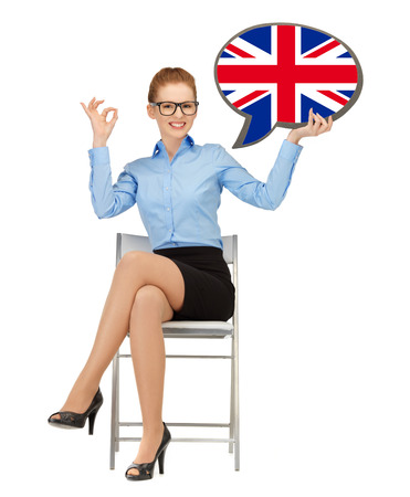 english girl: education, foreign language, english, people and communication concept - smiling woman holding text bubble of british flag and showing ok gesture