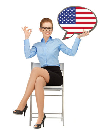 foreign country: education, foreign language, english, people and communication concept - smiling woman holding text bubble of american flag and showing ok gesture Stock Photo