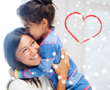 asian lady: childhood, happiness, family and people concept - smiling little girl and mother hugging indoors