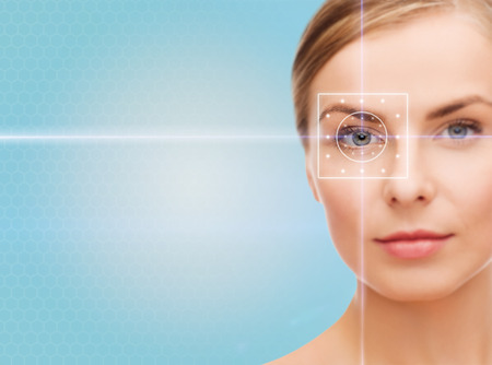 health, medicine, identity, vision and people concept - beautiful young woman with laser light lines on her eye over blue Standard-Bild