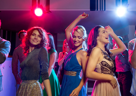 girls night: party, holidays, celebration, nightlife and people concept - smiling friends dancing in club