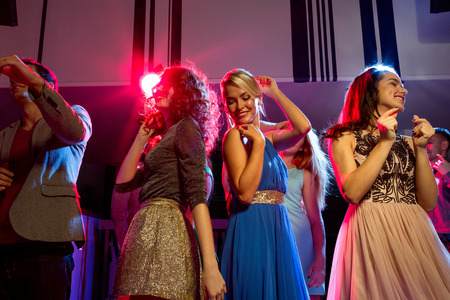 bachelorette party: party, holidays, celebration, nightlife and people concept - smiling friends dancing in club