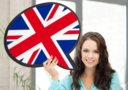 english text: education, foreign language, english, people and communication concept - smiling woman holding text bubble of british flag Stock Photo