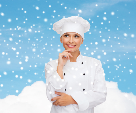 christmas cooking: christmas, cooking, holidays and people concept - smiling female chef, cook or baker dreaming over sky and cloud