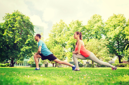 fitness, sport, training and lifestyle concept - smiling couple stretching outdoors Stock Photo - 34509496