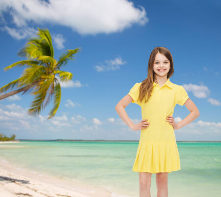 pre adolescence: happiness, childhood and people concept - smiling little girl in yellow dress