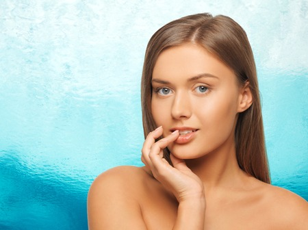 chubby girl: beauty, people and health concept - beautiful young woman touching her lips over ripple blue water background