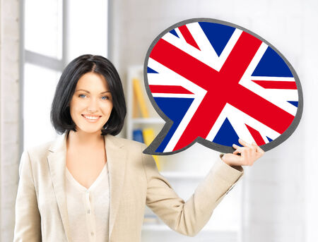 british people: education, foreign language, english, people and communication concept - smiling woman holding text bubble of british flag Stock Photo