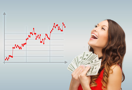 win money: business, people and money concept - smiling businesswoman with dollar cash money over gray background and forex graph going up
