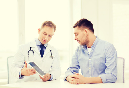 urologist: healthcare, technology and medicine concept - serious doctor with tablet pc computer and patient in hospital