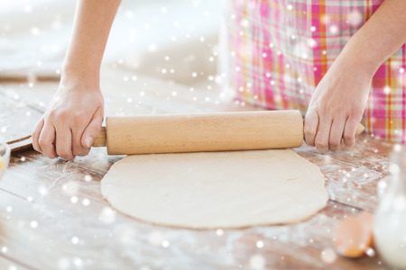 rollingpin: cooking and home concept - close up of female working with rolling-pin