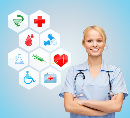 healthcare, medicine, people and symbols concept - smiling young female doctor or nurse over medical icons and blue background photo
