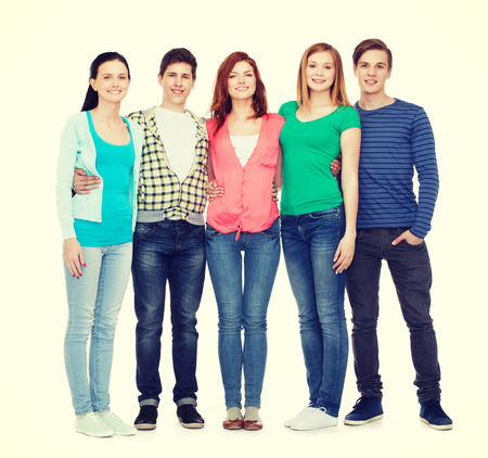 school friends: education and people concept - group of smiling students standing
