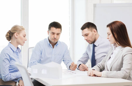 co workers: business, architecture and office concept - concerned team of architects and designers in office Stock Photo