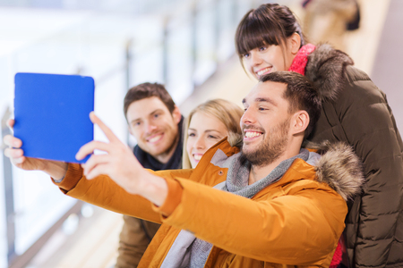 latin man: people, friendship, technology and leisure concept - happy friends taking selfie with tablet pc computer on skating rink