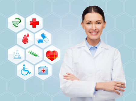 healthcare, medicine, people and symbols concept - smiling young doctor or nurse over medical icons and blue background photo