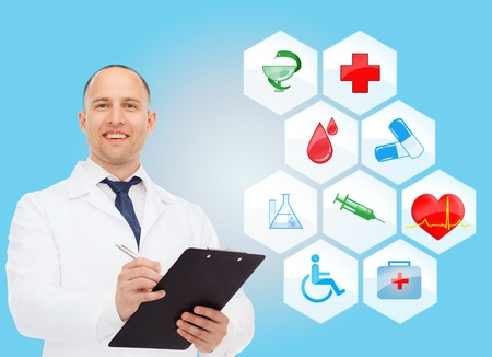 red cross: healthcare, profession, symbols, people and medicine concept - smiling male doctor with stethoscope in white coat over blue background with medical icons Stock Photo