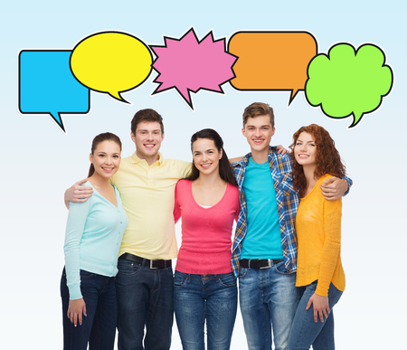friendship, communication and people concept - group of smiling teenagers over white background with text bubbles photo