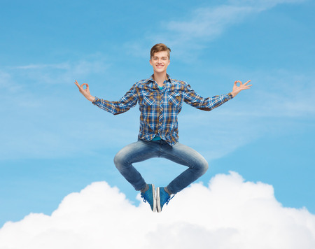flying man: happiness, freedom, movement and people concept - smiling young man flying in air