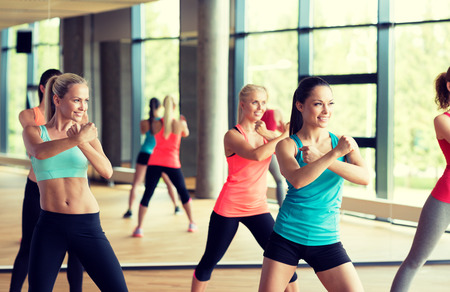 fitness, sport, training, gym and lifestyle concept - group of women working out in gym Stock Photo