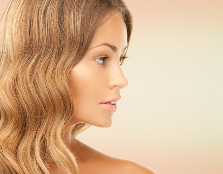 long nose: beauty, people and health concept - beautiful young woman face over pink background