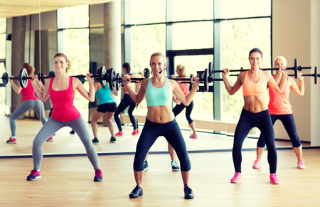 gym class: fitness, sport, training and lifestyle concept - group of women with barbells in gym