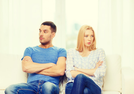 emotional love: love, family and happiness concept - unhappy couple not speaking after having argument at home