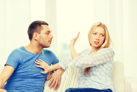 argument from love: love, family and happiness concept - unhappy couple having argument at home