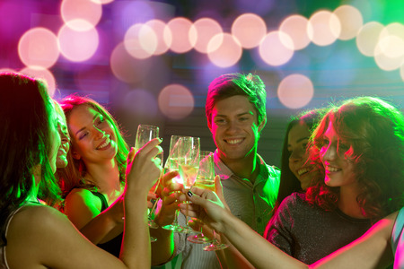 bachelorette: party, holidays, celebration, nightlife and people concept - smiling friends with glasses of champagne in club