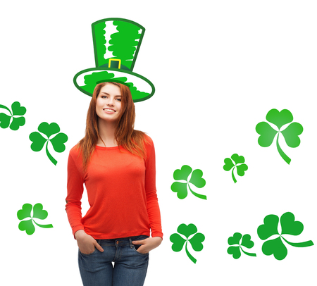 female leprechaun: gestures, holidays, st. patricks day and people concept - happy teenager in green top hat over white background with shamrock or clover