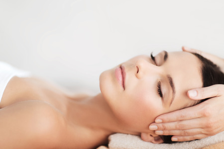 facial  spa: spa, resort, beauty and health concept - beautiful woman in spa salon getting face treatment