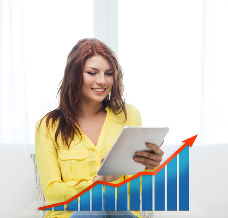 people, technology, statistic sand business concept - smiling woman with tablet pc computer and growth chart at home photo