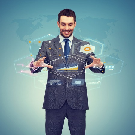 business, technology, communication concept - smiling businessman working with virtual screen Stock Photo