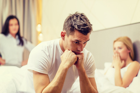 sexual activities: hotel, travel, relationships and sexual problems concept - wife caught man cheating with another woman