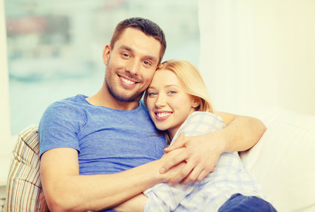 new: love, family and happiness concept - smiling happy couple at home