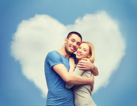 romantic couple: love and family concept - smiling couple hugging