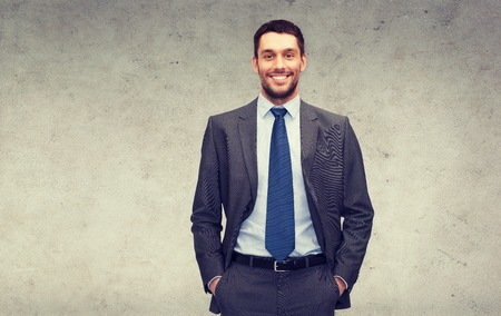 gray suit: business and office concept - handsome buisnessman
