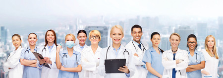 healthcare and medicine concept - smiling female doctors and nurses with stethoscope Stock Photo
