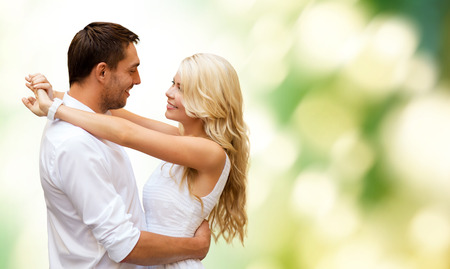 summer holidays, people, love and dating concept - happy couple hugging over green background photo