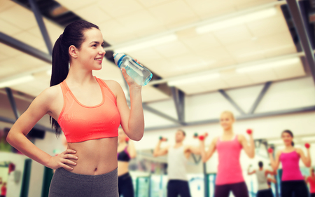 stamina: sport, exercise and healthcare - sporty woman with water bottle