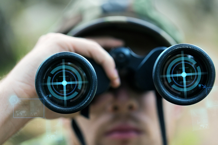 war: hunting, war, army and people concept - close up of young soldier, ranger or hunter with binocular and virtual projection observing forest